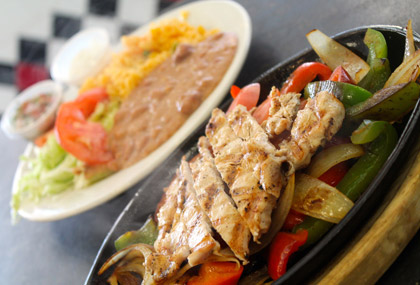 Chicken Fajitas with Spanish Rice, Refried Beans, Pico de Gallo, Sour Cream, Lettuce, Tomato and your choice of Corn or Flour Tortillas. Tuesday's ALWAYS Fajita day!