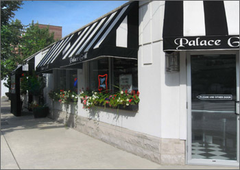 Sidewalk view of Palace Grill Restaurant on Madison Street in Chicago